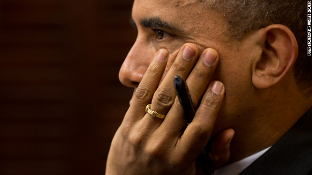 Obama receives an update from officials on the response to Hurricane Sandy in the Situation Room of the White House on Oct. 30, 2012.