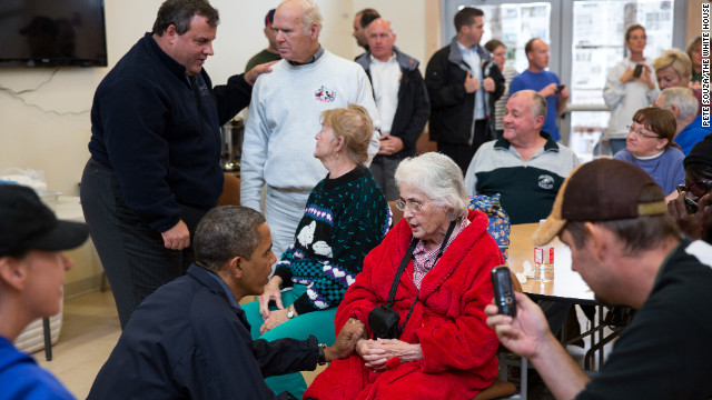 Obama and New Jersey Gov. Chris Christie talk with local residents at the Brigantine Beach Community Center in Brigantine, New Jersey, on Oct. 31, 2012.