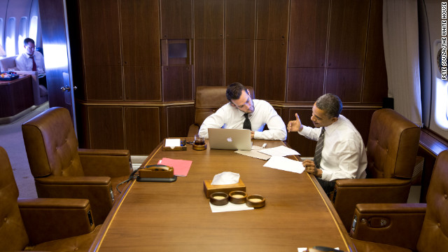 Obama works with Jon Favreau, director of speechwriting, aboard Air Force One en route to Green Bay, Wisconsin, on Nov. 1, 2012.