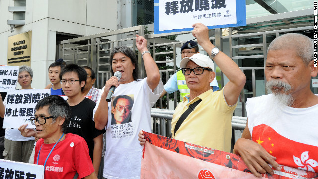Hong Kong legislator Leung Kwok-hung (C), also known as &quot;Long Hair,&quot; recently demanded for the release of Chinese dissident Liu Xiaobo during a protest outside the Chinese liaison office in Hong Kong -- emphasizing the commitment to free speech in the city.