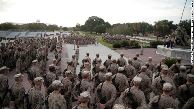 Recruits of Bravo Company, 1st Recruit Training Battalion, gather at Parris Island's Iwo Jima statue to receive their Eagle, Globe and Anchors last August. Each drill instructor presents their recruits with a small eagle globe and anchor emblem, shakes their hands, calls them Marines for the first time and tells them, &quot;job well done.&quot;