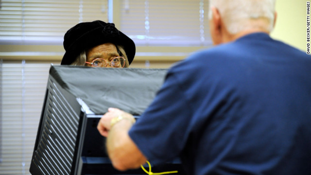 Phignora Brown, left, gets assistance from a polling station worker as she casts her ballot on the first day of early voting in Las Vegas on October 20.