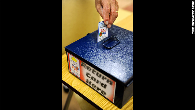 Electronic voting authorization cards are returned at the East Las Vegas Community Center polling station on October 20.