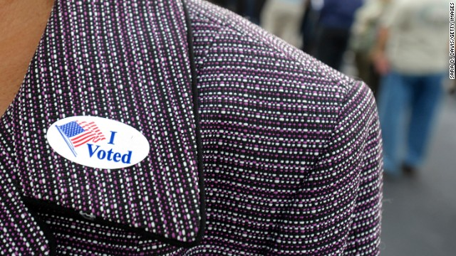 A voter displays an &quot;I Voted&quot; sticker on her lapel after voting early in Wilson, North Carolina, on October 18.