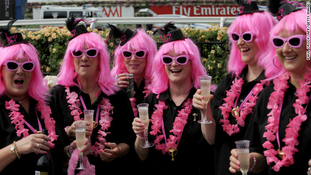 These racegoers toast the day ahead of the main race. Ten races are being run throughout the day, over varying distances. 