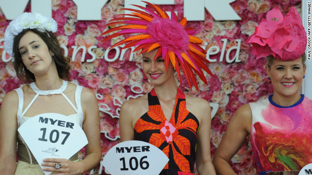 "Entrants line up for the ""Fashion on the Field"" competition, which typically attracts more than 1,100 male and female ""clothes horses."" Competitors are judged on originality, accessories and their understanding of current trends. Prizes include a Lexus convertible."