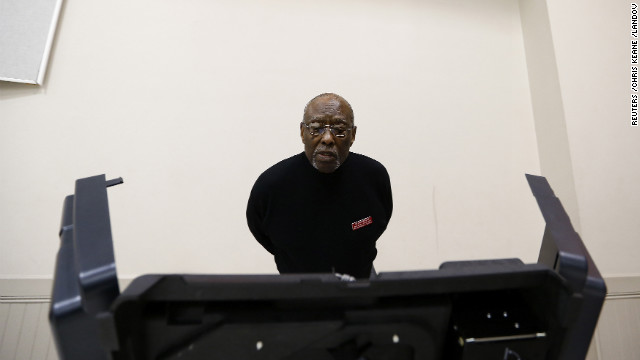 Precinct official Bill Partlow inspected a voting machine before polls open Tuesday in Pineville, North Carolina.