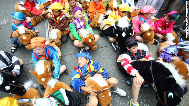 Children dressed as jockeys take a break before the parade starts on November 5, 2012 in Melbourne, Australia. 