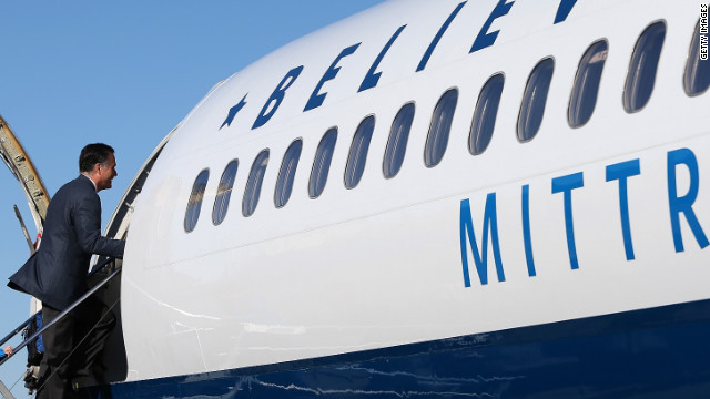 Romney boards his campaign plane in Bedford, Massachusetts. The Romney camp has decided to continue campaigning on Election Day.