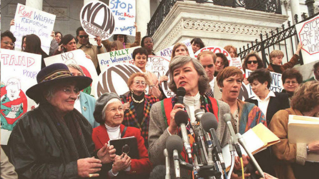 U.S. Rep. Patricia Schroeder speaks at a vigil to protest welfare reform on Capitol Hill in 1995 as former Rep. Bella Abzug, left, looks on.