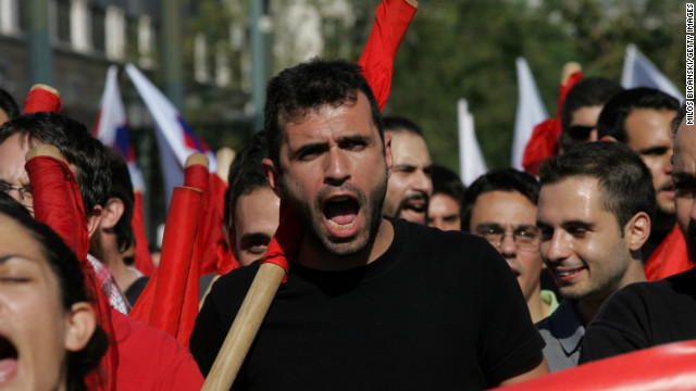 Demonstrators shout slogans against new austerity measures required for the bailout package.