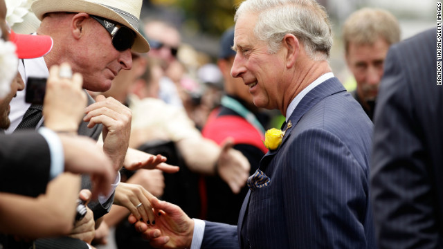 Prince Charles, Prince of Wales greets a racegoer on Melbourne Cup Day at Flemington Racecourse on November 6, 2012.