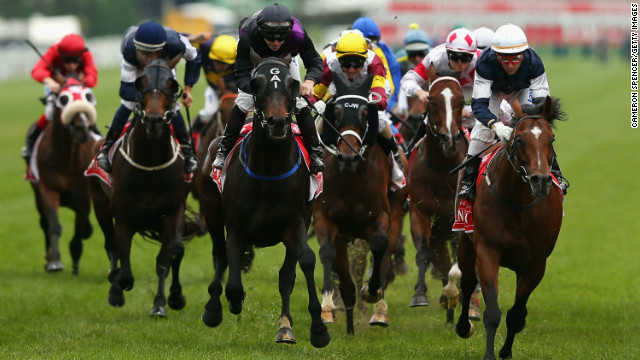 Brett Prebble riding Green Moon crosses the finish line to win the 2012 Melbourne Cup. The six-year-old Bay Stallion is owned by Australian businessman Lloyd Williams who now has four Cup wins. Green Moon defeated the Gai Waterhouse-trained Fiorente, with Jakkalberry third.