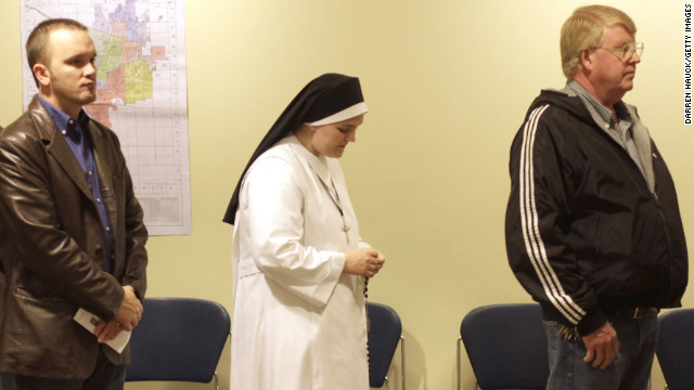 A nun waited in line to cast her vote in Janesville, Wisconsin.
