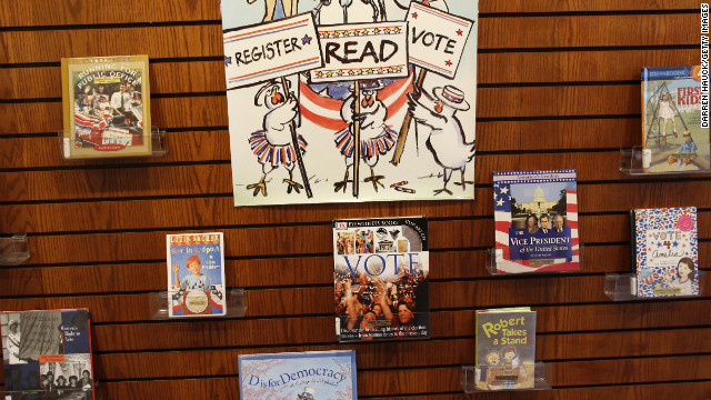 Children's books about politics lined a wall where citizens waited to cast their vote in Janesville, Wisconsin.