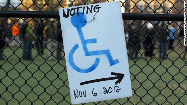 A sign directs disabled voters to a polling site entrance at the Graham &amp; Parks School in Cambridge, Massachusetts.