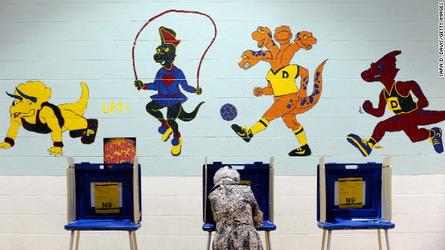 A voter casts her ballot in the gymnasium of Douglas Elementary School in Raleigh, North Carolina.