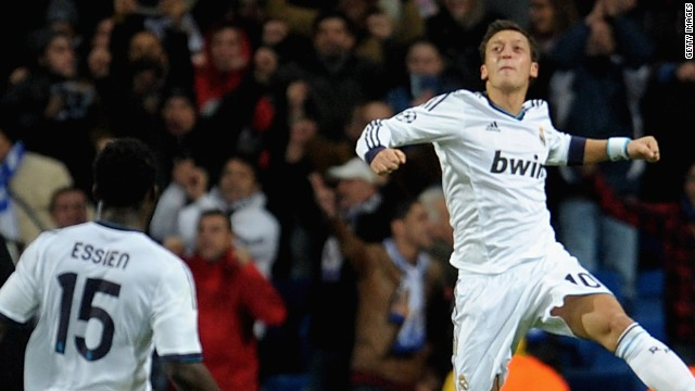 Mesut Ozil goes airborne to celebrate his late equalizer against Borussia Dortmund in the Bernabeu.