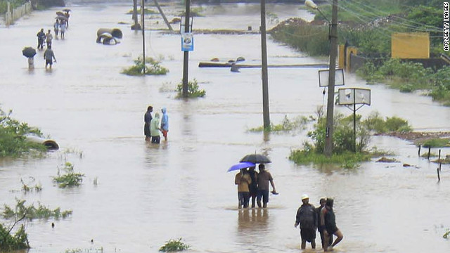 Indian residents wade through flood waters in Visakhapatnam in the coastal district of Andhra Pradesh on November 5, 2012.