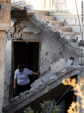 A picture released by the Syrian Arab News Agency shows damage caused by a mortar attack in a residential district of Damascus, Syria, on Wednesday.