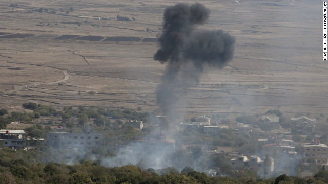 Israel returns fire into Syria in warning over spillover violence