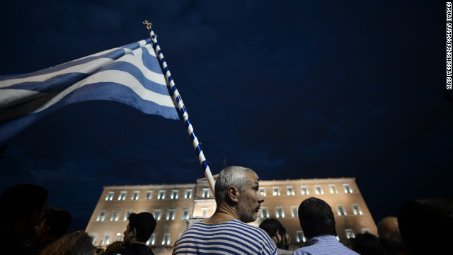 Demonstrators stand in front of the Greek Parliament in Athens on November 7, 2012 during a 48-hour general strike.