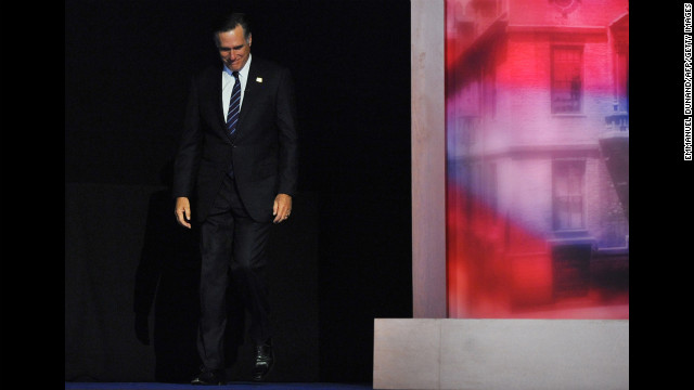 Republican candidate Mitt Romney hung his head and smiled as he strode onto the stage to give his concession speech.