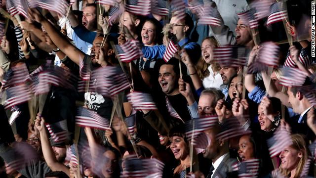 A blur of waving flags greeted President Barack Obama's victory speech at an election night event in Chicago, Illinois.