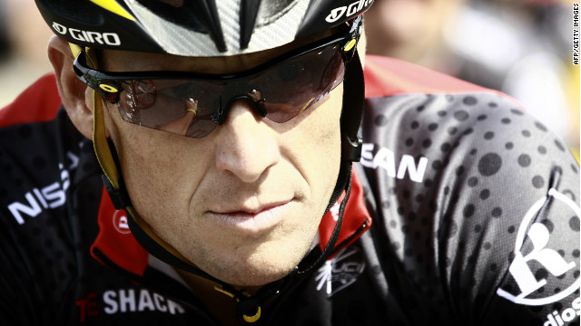 Lance Armstrong rides in a training session after leaving the hotel hosting the US cycling team Radioshack on July 1, 2010.