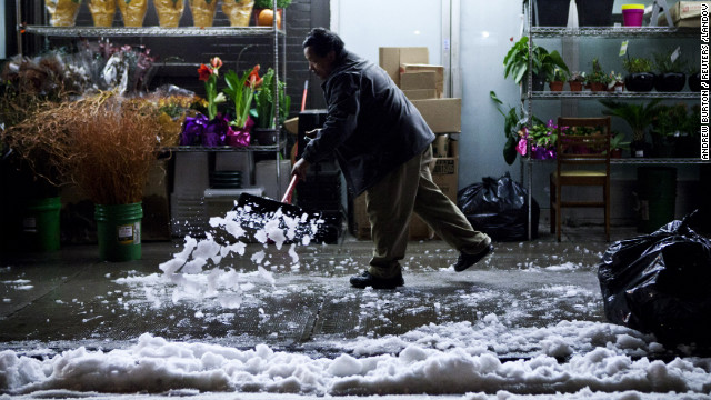 A man shovels snow dropped by a nor'easter on the Lower East Side of Manhattan on Thursday, November 8.