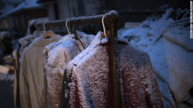 Snow covers clothes hanging outside a home that was destroyed by Sandy in Staten Island, New York, on Wednesday. 