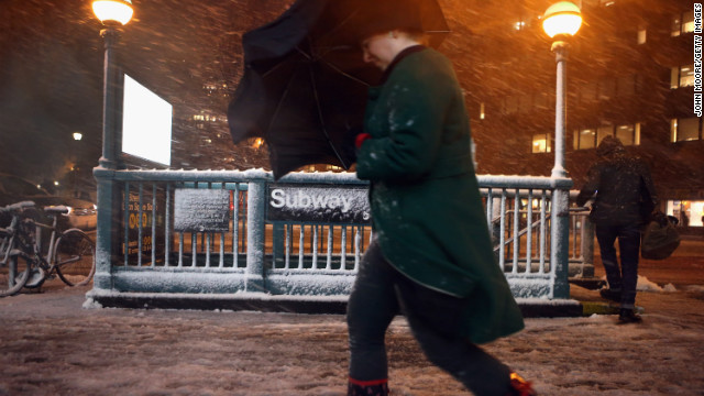 Pedestrians walk through high winds and snow near Union Square on Tuesday, November 6, in New York.