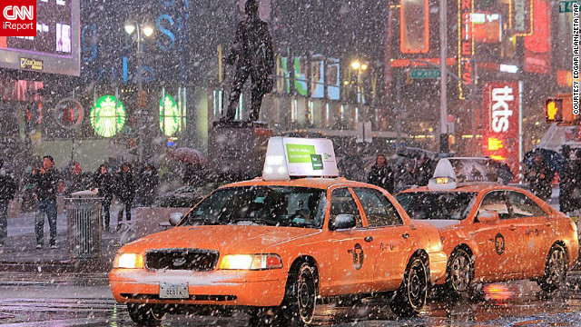 Cabs and pedestrians navigate the snow from a nor'easter falling in Manhattan on Wednesdayin this photo taken by<a href='http://ireport.cnn.com/docs/DOC-877979' target='_blank'> CNN iReporter Edgar Alan Zeta Yap</a>.