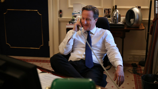 Photo: David Cameron congratulates Obama