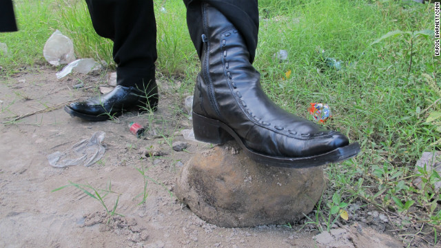 Leather Sapeur shoes have detailed stitching and are glossy on the dirt walkways.