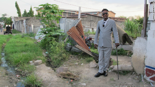 Even with widespread poverty surrounding them the Sapeurs revel in an opportunity to show off their expensive threads.