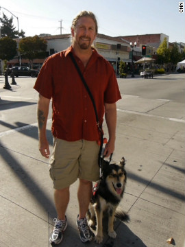 "Lobo helps Jeff Wilson keep cool in public places. Wilson doesn't like being startled, so with a simple ""watch my back"" command, the border collie-German shepherd mix watches Wilson's 6 o'clock and gives him a little nudge if anyone walks up behind him at the grocery story or other public setting. If Wilson's anxiety kicks in, Lobo will jump and put his paws on Wilson's chest to give him something else to focus on."