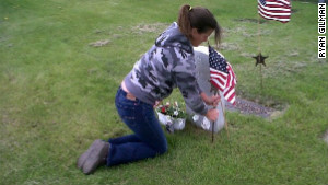 The writer decorates her dad\'s grave on Memorial Day.