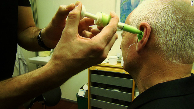 The first part of building the Widex hearing aid requires a mold of the ear canal to be made, as CNN's Nick Glass demostrates.