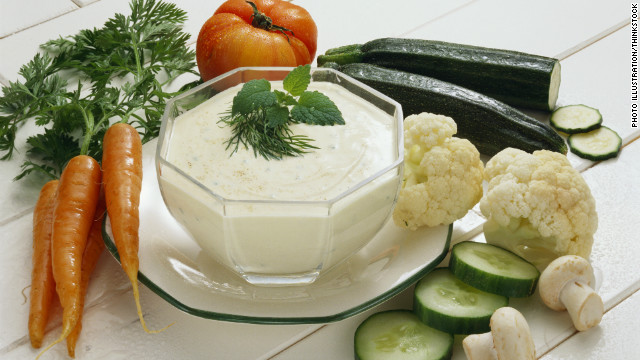 Consider eating a light snack before the big meal, like a low-calorie dip and some vegetables or yogurt in order to control your appetite.