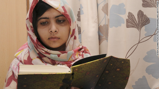 Malala Yousufzai, 15, reads a book on November 7 at the hospital.