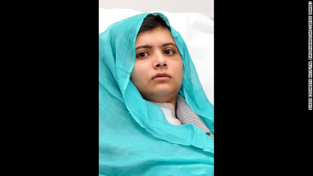 Malala sits up in bed on October 25 after surgery for a gunshot wound to the head.