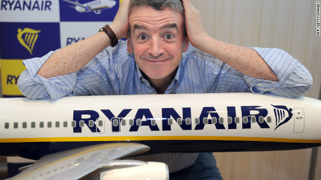 Michael O'Leary, CEO of Irish airline Ryanair, poses on a model Ryanair airplane on August 23, 2012.