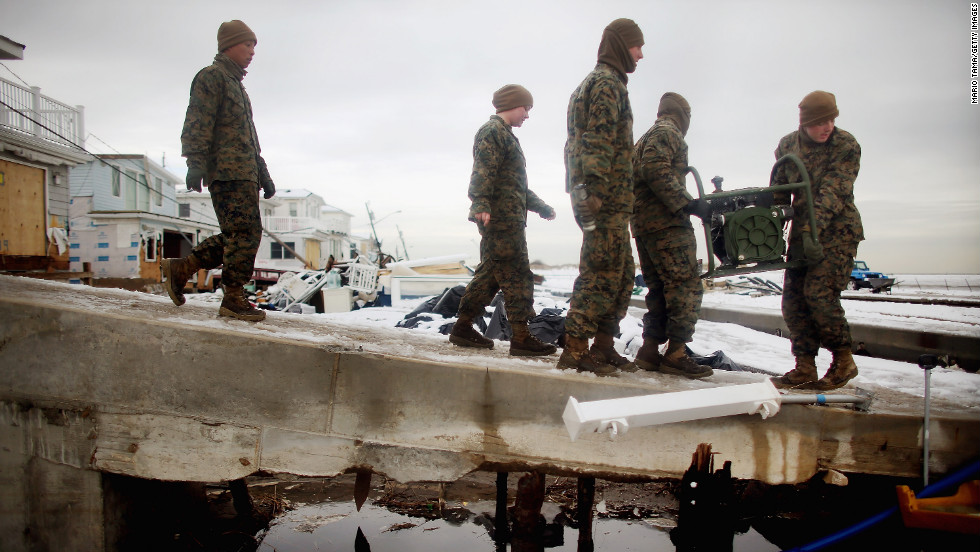 U.S. Marines from the 8th Engineer Support Battallon out of Camp Lejeune, North Carolina, move a generator to pump out floodwater from a street after a nor'easter on Thursday, November 8, in the Breezy Point neighborhood of Queens, New York. The nor'easter, which dumped 2 feet of snow in some places, complicates Superstorm Sandy recovery efforts. That storm killed at least 111 people in the region and knocked out power to millions of customers. <a href='http://www.cnn.com/2012/10/30/us/gallery/sandy-damage/index.html' target='_blank'>See photos of the aftermath of Sandy</a>.