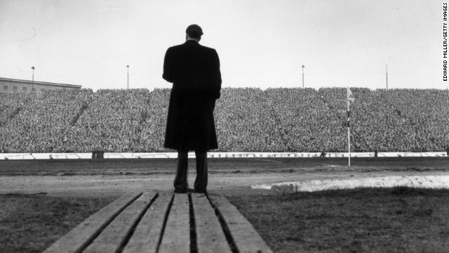 Graham addresses a crowd of football supporters at Stamford Bridge, London, during half-time at a match between Chelsea and Newcastle United on April 24, 1954.
