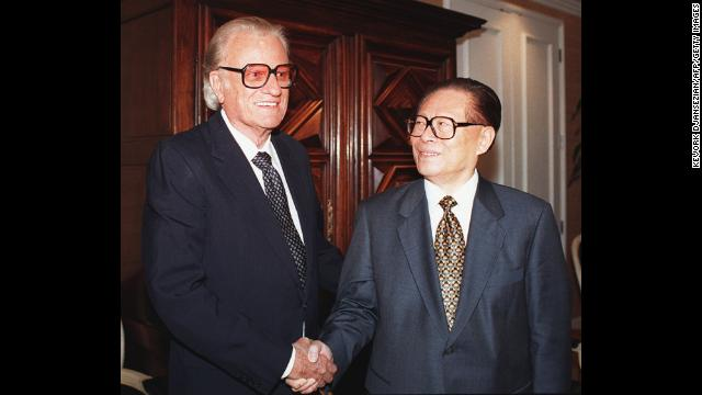 Graham greets Chinese President Jiang Zemin at a VIP luncheon in November 1997 in Beverly Hills, California.
