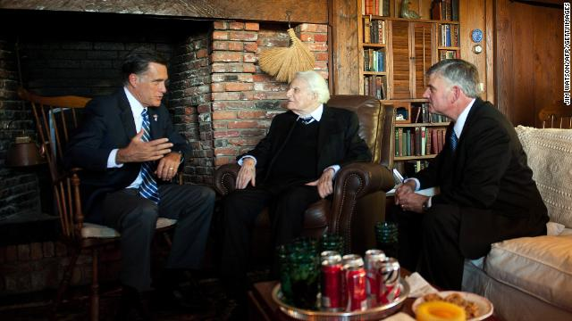 Republican presidential candidate Mitt Romney speaks with Graham and his son Franklin during a visit to the Grahams' cabin in Montreat on October 11, 2012.
