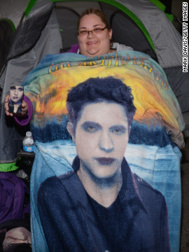 A fan shows off her &quot;Twilight&quot; phone case and blanket.