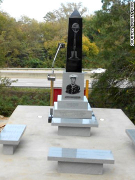 "This monument will replace the wooden sign overlooking I-75. Visitors will be able to sit on four benches, reflecting on Davis' bravery and the text written on the lighted black and gray granite monument. The obelisk features a likeness of Davis and an etching of a helmet, rifle and boots forming a cross. One panel reads: ""May this monument be a beacon of love that shines on all those who contribute to the many efforts needed to completely restore Linwood Cemetery."""