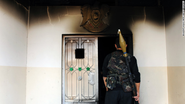 A Syrian opposition fighter walks in a destroyed house after hard clashes with Syrian regime forces in Ras al Ain on Saturday, November 10.